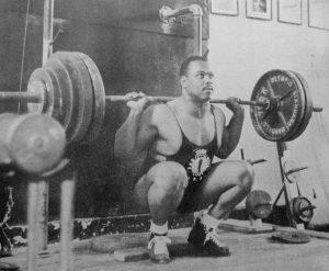 John Davis performing a squat